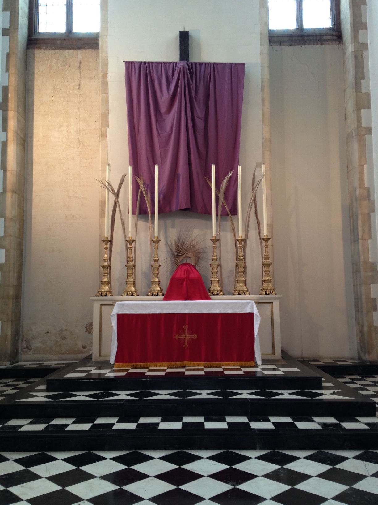 Our new red altar frontal, with the sanctuary ready for Palm Sunday